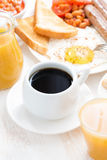 traditional breakfast - coffee, juice, eggs and toasts Royalty Free Stock Image