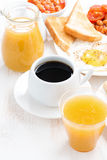 Traditional breakfast - coffee, juice, eggs, toasts on white Royalty Free Stock Images