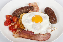 Traditional Breakfast of Egg, Bacon, Sausages, Tomato and Toast Royalty Free Stock Image