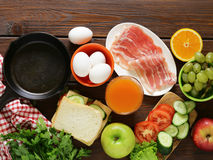 Traditional breakfast - eggs, bacon, toast. And vegetables Stock Image