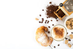 Traditional breakfast with fresh croissants and coffee. On white background top view horizontal Stock Images