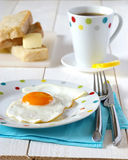 Traditional breakfast of fried egg, bread and butt Royalty Free Stock Photography
