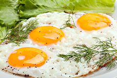 Traditional breakfast with fried eggs and herbs Stock Photo