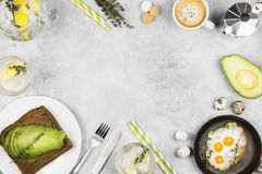 Traditional breakfast - toast from rye bread with avocado, fried Royalty Free Stock Photo