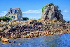 Traditional breton stone house and the rock, Brittany, France Royalty Free Stock Photos