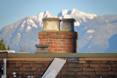 Traditional Brick Chimney Stack and Flues Stock Image