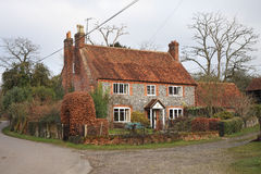 Traditional Brick and Flint English farmhouse Stock Images