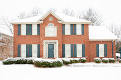 Traditional brick home in the winter. Traditional two story brick home with snow in winter Stock Photos