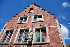 Traditional brick house in city of Bruges. Traditional brick house facade in the city of Bruges, Belgium Royalty Free Stock Photos