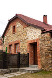 Traditional brick-stone house Stock Image