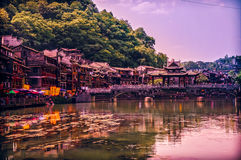 Traditional bridge and buildings on waterfront in Fenghuang (Pho Royalty Free Stock Photography