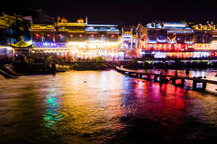 Traditional bridge and buildings on waterfront at night in Fengh Royalty Free Stock Photo