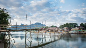 Traditional bridge. Cross Song river  betwween island to island in Vang-Vieng, Lao Royalty Free Stock Photo