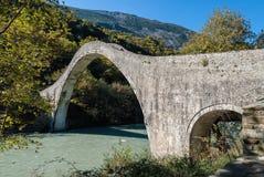 Traditional bridge in Greece. The historical Plaka bridge in Epirus, Greece Stock Photo
