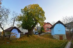Traditional Brightly painted wooden sheds and stores at Hervartov. Brightly painted wooden sheds and stores at Hervartov. Hervartov is a village and municipality stock image