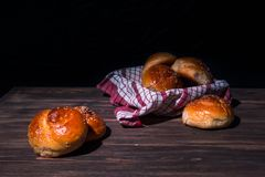 Traditional brioches on wooden table. Stock Photos