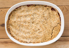 Traditional british apple crumble pie in dish Royalty Free Stock Images