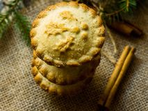 Traditional British Christmas Pastry Dessert Home Baked Mince Pies with Apple Raisins Nuts Filling Stacked on Burlap Background stock images