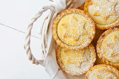 Traditional British Christmas Pastry Dessert Home Baked Mince Pies with Apple Raisins Nuts Filling in Wicker Basket Stock Photography