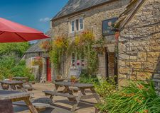 Traditional British country Pub at Frampton Mansell in The Cotswolds royalty free stock image