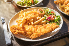 Traditional British fish and chips. Fried fish fillet with french fries Royalty Free Stock Images