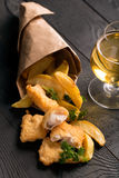 Traditional British fish and chips with parsley Royalty Free Stock Image
