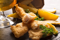 Traditional British fish and chips with parsley Stock Photo