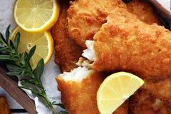 Traditional British fish and chips with potato and lemon. Traditional British fish and chips with potato and lemon stock photo