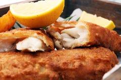 Traditional British fish and chips with potato and lemon. Traditional British fish and chips with potato and lemon stock photography