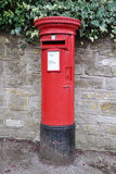 Traditional British Post Box. Traditional British pillar type red post box Stock Photography