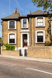 Traditional British Victorian detached house built in bricks wit Royalty Free Stock Photos