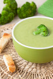 Traditional broccoli green cream soup recipe with. Traditional broccoli green cream vegan soup recipe with croutons on vintage background Royalty Free Stock Image