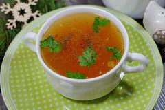 Traditional broth served at Christmas dinner Stock Images