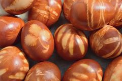 Traditional Easter eggs dyed with natural onion peels and leaves. Traditional brown Easter eggs dyed with natural onion peels and leaves royalty free stock photos