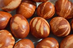 Traditional Easter eggs dyed with natural onion peels and leaves. Traditional brown Easter eggs dyed with natural onion peels and leaves stock images