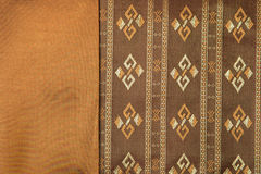 Traditional brown Thai fabric pattern Royalty Free Stock Photo