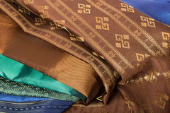 Traditional brown Thai fabric pattern Royalty Free Stock Images