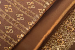 Traditional brown Thai fabric pattern Royalty Free Stock Image