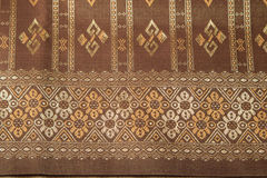 Traditional brown Thai fabric pattern Stock Image