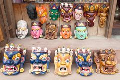 Traditional Buddhist festival masks. On a shop Royalty Free Stock Photos