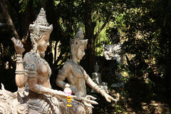 Traditional buddhist sculptures in forest Stock Photography