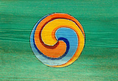 Traditional Buddhist Symbol. A painted Buddhist symbol on a green wooden door. Photographed at Beomosa Temple in Pusan royalty free stock photos
