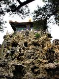 Traditional building in China, nature, rocks, roof and trees. Traditional building in China, nature, rocks, roof, trees, architecture, art, tradition, enchanting royalty free stock photo