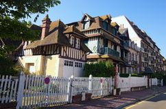A traditional building in the city of Deauville, Calvados department of Normandy, France. Beautiful spring morning landscape.  Royalty Free Stock Photography