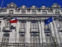 Traditional building with flags in Valparaiso, Chile Stock Photography