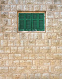 Traditional Building with Green Shutters (Lebanon). Traditional mountain style building  built of native  limestone with green wooden shutters on the windows ( Royalty Free Stock Images