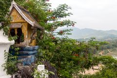 The traditional building of the House of Ghosts. On a cliff above the valley, Luang Prabang, Laos Stock Photography