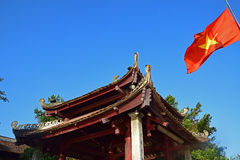 A traditional building roof with Vietnamese flag Royalty Free Stock Image