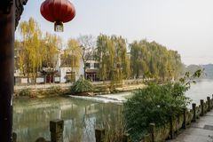 Traditional buildings along balustraded riverside in sunny winter afternoon. Chengdu,China royalty free stock photo