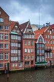 Traditional buildings along canal in Hamburg Royalty Free Stock Photos